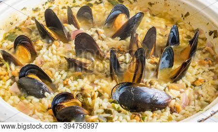 Mediterranean Dish - Risotto With Mussels In A Large Enameled Pan, Italian, Greek Cuisine