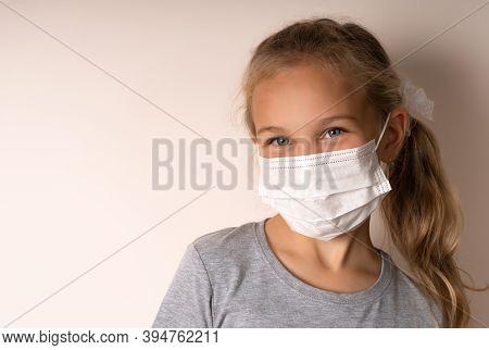 Cute Little Girl Wearing A Medical Mask