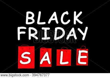 Red Paper Shopping Bags, Packs On Background Canvas. Black Friday Sale Concept. Best Deal Offer To B