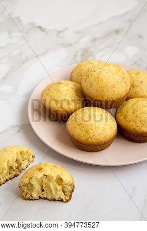 Homemade Cornbread Muffins On A Pink Plate, Side View. Copy Space.