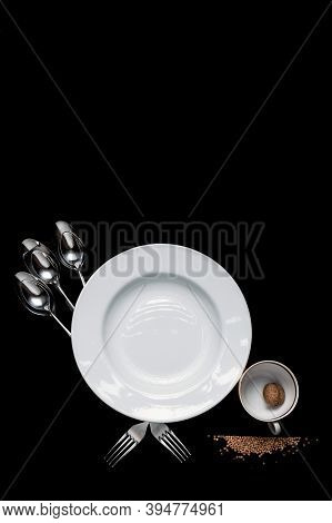 Bird From A Plate, Cup And Cutlery With An Eye Made Of Walnut, Pecks Buckwheat Spilled On A Black Ba