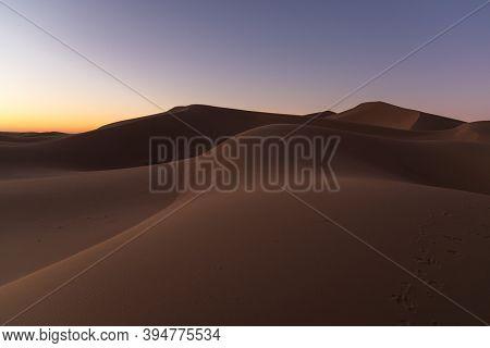 Dreamy Desert Concept At Twilight Of Dawn At Desert Dune Of Erg Chigaga, At Sahara. Morocco. Concept