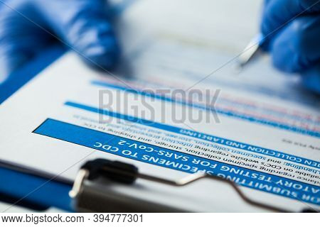 Laboratory Technician Checking Cdc Specimen Submitting Form, Laboratory Testing For Sars-cov-2 Covid