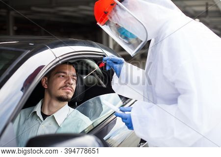 Covid-19 Drive-thru Rt-pcr Detection,car Checkpoint Diagnostic,medical Worker Performing Nasal Swab