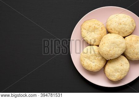 Homemade Flaky Buttermilk Biscuits On A Pink Plate On A Black Background, Top View. Flat Lay, Overhe