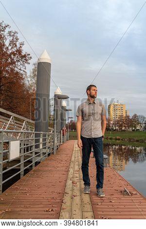 Portrait Of Young Caucasian Man Walking On Shipyard On Vltava River In Ceske Budejovice City