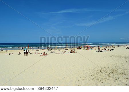 An Amazing Surfers Paradise Beach With Tourists In Gold Coast