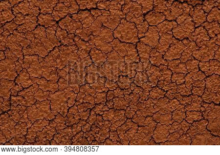 Brown Dried Cracked Ground Close Up. Grunge Background. Drought On The Earth.