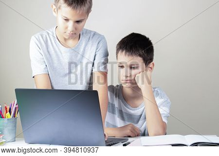 Learning Difficulties, School, Remote Education, Online Learning At Home. Two Kids Using Laptop Comp