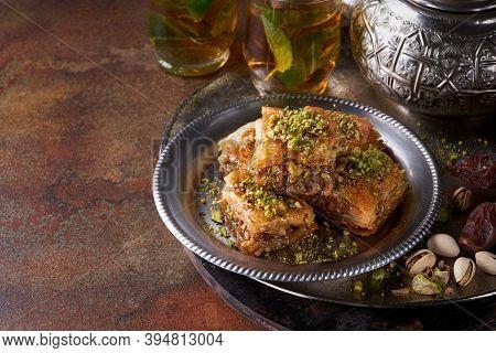 Baklava Or Baklawa, Ramadan Dessert. Traditional Arabic Dessert With Pistachios, Honey And Mint Tea