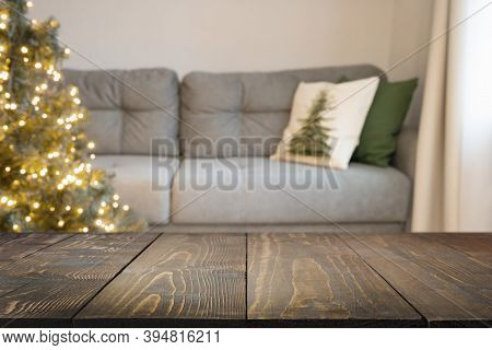 Blurred Home Interior In Living Room, Decorated Christmas Tree, Wooden Tabletop For Display Products
