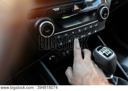 Interior View Of A Modern New Car. Climate Or Air Conditioner System Adjusted By A Man. Adjusting Te