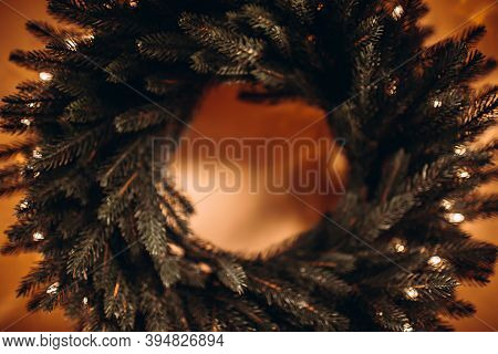 Defocused Background Image Of Christmas Wreath On Wall.