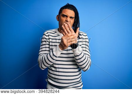 Young handsome african american afro man with dreadlocks wearing casual striped sweater Suffering pain on hands and fingers, arthritis inflammation