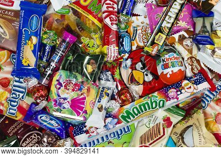 Moscow, Russia - January 02, 2016: Kinder Surprise, Angry Birds, Lindor, Kit Kat, Milky Way, Tempo,