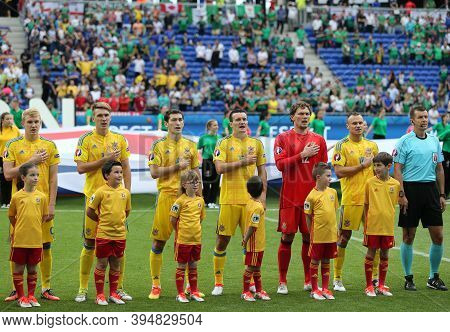 Lyon, France - June 16, 2016: Players Of Ukraine National Football Team Listen To National Anthem Be