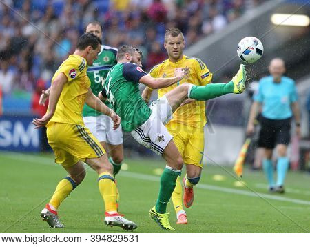 Lyon, France - June 16, 2016: Stuart Dallas Of Northern Ireland (c) Fights For A Ball With Ukrainian