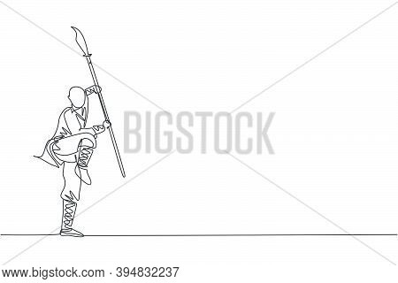 Single Continuous Line Drawing Of Young Muscular Shaolin Monk Man Holding Spear Training At Shaolin