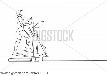 Single Continuous Line Drawing Young Sportive Woman Training With Elliptical Cross In Sport Gymnasiu