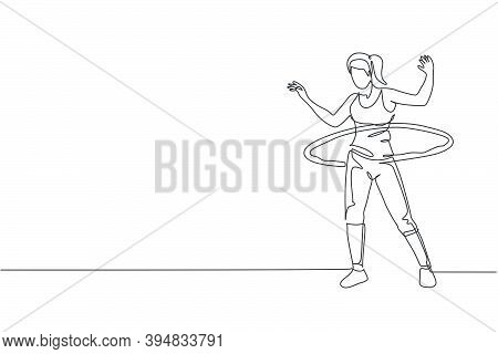 Single Continuous Line Drawing Of Young Sportive Woman Happy Training With Hula Hoop In Sport Gymnas