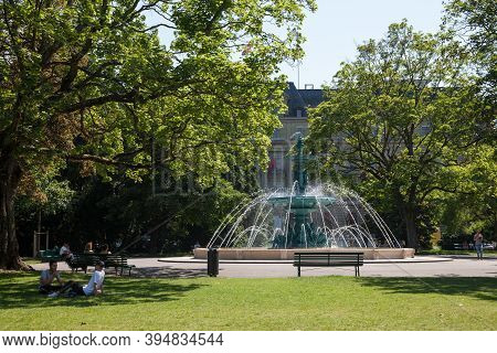 Geneva, Switzerland - June 19, 2017: People Relaxing On The Lawns Of The Jardin Anglais In Geneva, I
