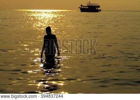 Sunset Idyllic With Silhouette Of Woman And Boat On Beach At Koh Chang Thailand. Koh Chang Is Locate