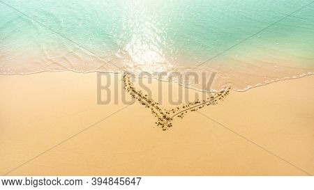 A Heart Shape Written On Golden Brown Sand Were Delete By  Pastel Green Color Water Frome The Sea On