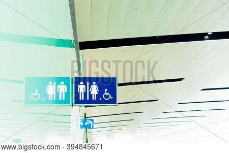 Toilet Sign For Male, Female And Handicap With Reflection And Public Drinking Water Sign At The Airp