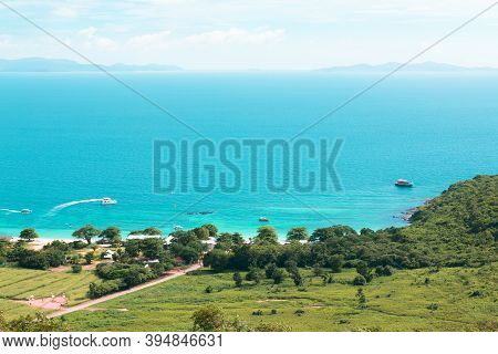 Aerial View From Koh Larn Of Thailand Overlooks The Sea During Day Time Amongst The Blue Sky. Koh La