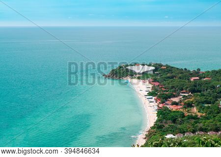 Aerial View From Thailand's Koh Larn Overlooking The Community And The Beaches With The Sea During T