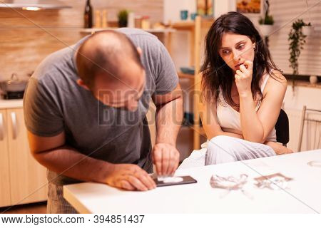 Couple Abusing Illegal Substance In Home Kitchen. Amphetamine Abuse With Side Effects Suffers From P