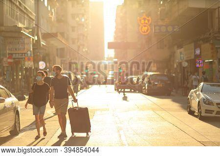 3 Oct 2020 The Traveller Cross The Sun Light At Mong Kok Street