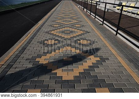 Brick Pavement Made Of Grey And Yellow Stone. Pavement Texture. Sidewalk Texture