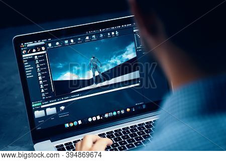 Male Developer Coding On Main Screen Of Unreal Engine Game Development Software On Macbook Macos Ope