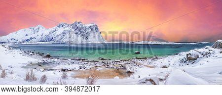 Fabulous Snowy Winter Scene Of  Vestvagoy Island With Snowy  Mountain Peaks On Lofoten Islands . Sun