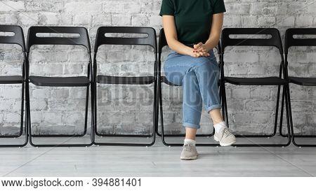 Confident Female Job Seeker Sitting In Corridor Of Temp Agency