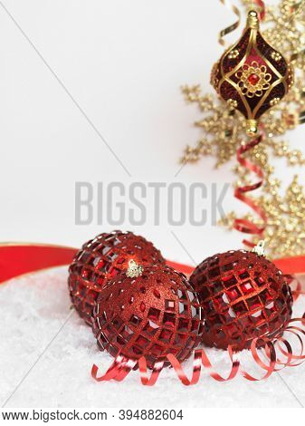 Red and gold Christmas decoration artistic still life on white background with snow