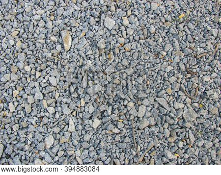 Gray Dirty Gravel Lies On The Ground