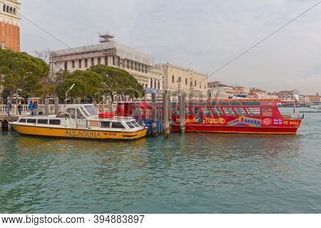 Venice, Italy - January 9, 2017: Long Red Boat For Tourists Sightseeing In Venezia, Italy.