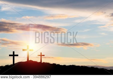 Silhouette Three Cross Or Crucifixion Of Jesus Christian On Top Of Mountain With Sunlight And Clouds