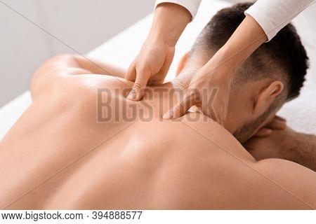 Closeup Of Man Getting Acupressure Massage At Spa Salon, Top View. Female Masseuse Massaging Unrecog