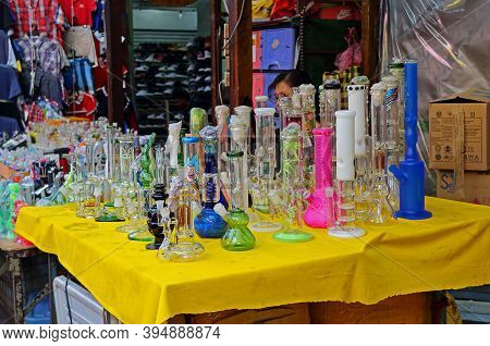 Kuala Lumpur, Malaysia - March 12, 2019: Selling A Variety Of Bong On The Petaling Street. A Bong Or