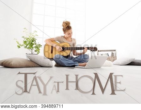 Young Woman With Computer Play Guitar, Look Laptop Monitor, With Stay At Home Text Isolated On White