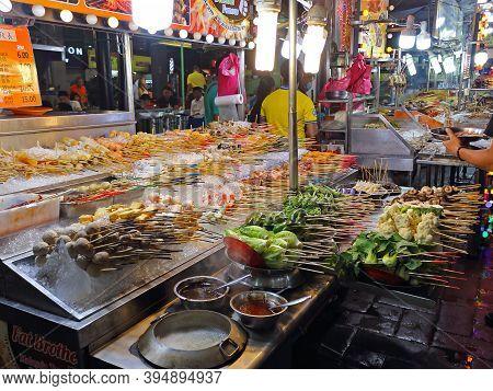 Kuala Lumpur, Malaysia - March 15, 2019: Jalan Alor Street Food Market. Food Stalls With Malaysian D