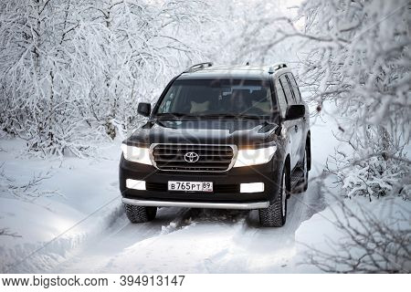 Novyy Urengoy, Russia - November 14, 2020: Black Luxury Offroad Car Toyota Land Cruiser 200 In The S