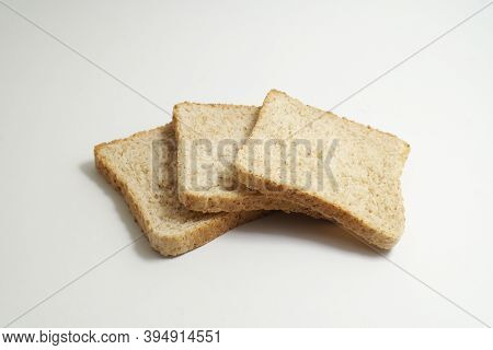 Slices Of Wholemeal Toast Bread On The White Backround, Ideal Food For Breakfast With Great Energy V