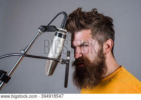 Bearded Man In Karaoke. Man Singing With A Microphones. Singing In Studio. Microphone. Sings A Song.
