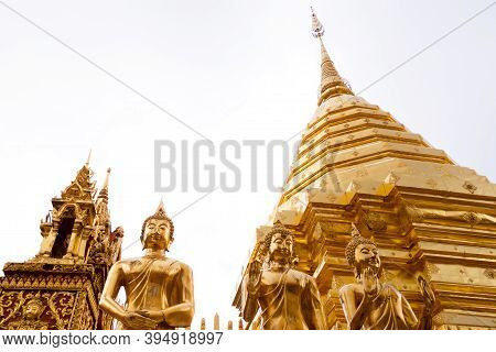 Golden Buddha Statues Around Golden Pagoda On White Background At Wat Phra That Doi Suthep Temple, C