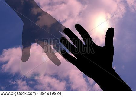 Silhouette Of Hand And Fading Hand Against The Sky,concept Image About Loss,support,fade Away