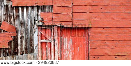 A Very Old Deserted Red Neglected Weathering Empty Abandoned Historic Farm Barn Building Structure S